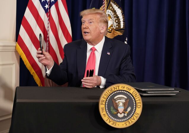 US President Donald Trump speaks after signing executive orders for economic relief during a news conference amid the spread of the coronavirus disease (COVID-19), at his golf resort in Bedminster, New Jersey, 8 August 2020.