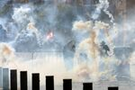 Riot police fire tear gas at demonstrators during a protest, following Tuesday's blast, in Beirut, Lebanon August 8, 2020.