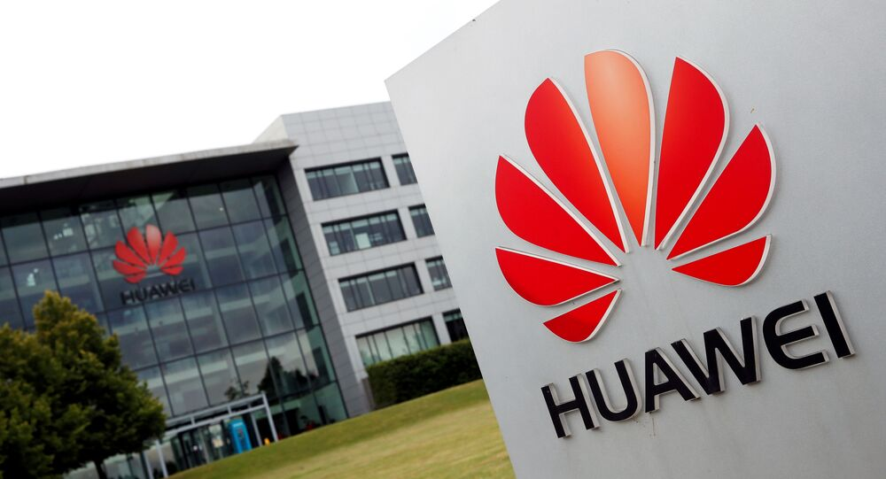 Huawei logo pictured outside its headquarters building in Reading, Britain, July 14, 2020.