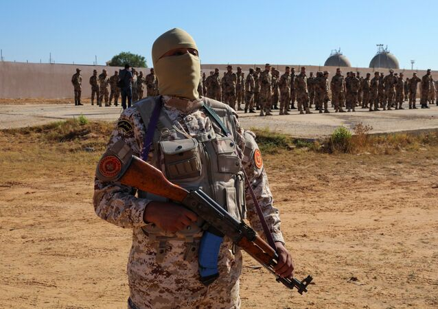 Members of the Petroleum Facilities Guard are seen at the Azzawiya oil refinery, in Zawiyah, west of Tripoli, Libya July 23, 2020.