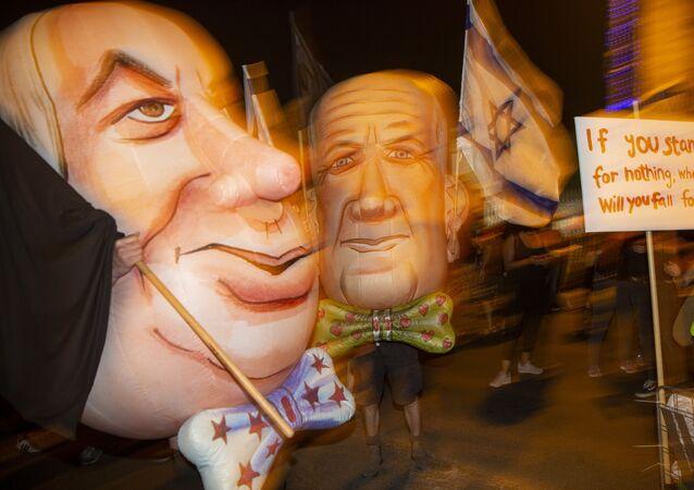 Demonstrators wear mask as Israel's Prime Minister Benjamin Netanyahu, left, and Defense Minister and coalition partner Benny Gantz, right, during a protest against Israel's Prime Minister Benjamin Netanyahu outside his residence in Jerusalem, Israel, Saturday, Aug. 8, 2020.
