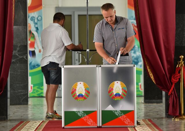 A man casts his ballot at a polling station during the presidential election in Minsk on August 9, 2020.