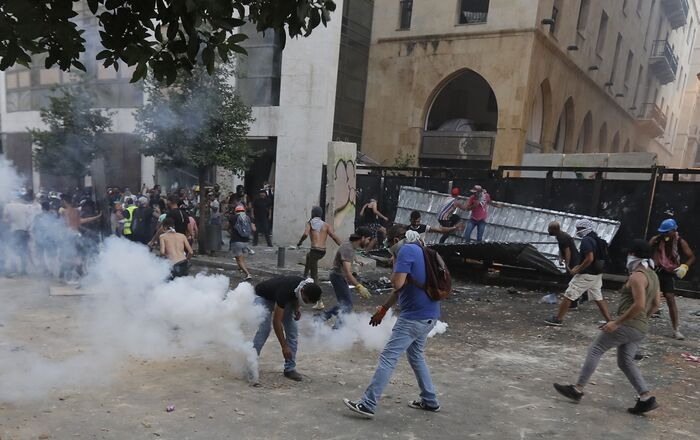 Lebanese protesters, enraged by a deadly explosion blamed on officials' negligence, clash with security forces for the second evening near an access street to the parliament in central Beirut on August 9, 2020.