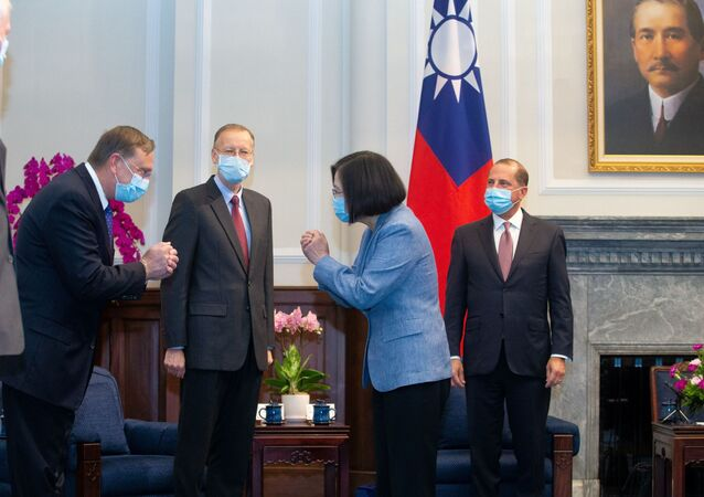 Taiwan President Tsai Ing-wen wearing a face mask meets U.S. delegation led by U.S. Secretary of Health and Human Services Alex Azar (R) at the presidential office, in Taipei, Taiwan August 10, 2020.