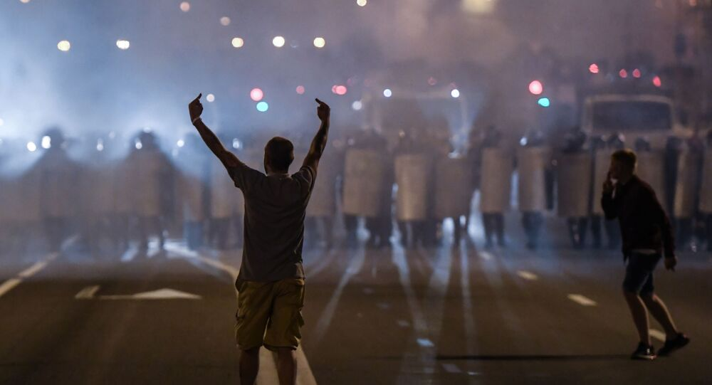 Protesters took to the streets of Minsk on Sunday night after official exit polls projected a landslide victory for the incumbent President Lukashenko.