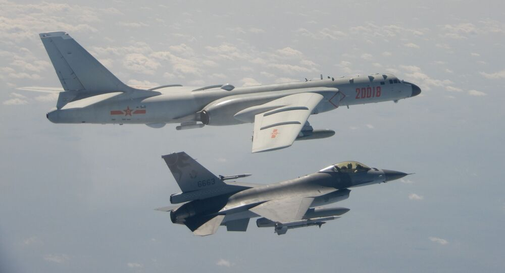 This handout photo taken and released on 10 February 2020 by Taiwan's Defence Ministry shows a Taiwanese F-16 fighter jet flying next to a Chinese H-6 bomber (top) in Taiwan's airspace.