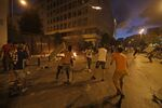 Lebanese protesters, enraged by a deadly explosion blamed on government negligence, clash with security forces for the second evening near an access street to the parliament in central Beirut on August 9, 2020.