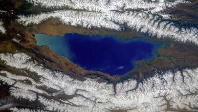 Between the ridges of the Northern Tien Shan in Kyrgyzstan, at an altitude of 1608 meters above sea level, there is a hot lake that does not freeze in winter - Issyk-Kul. It is the main local tourist attraction. Guests from different countries are attracted by the healing climate and numerous health resorts.