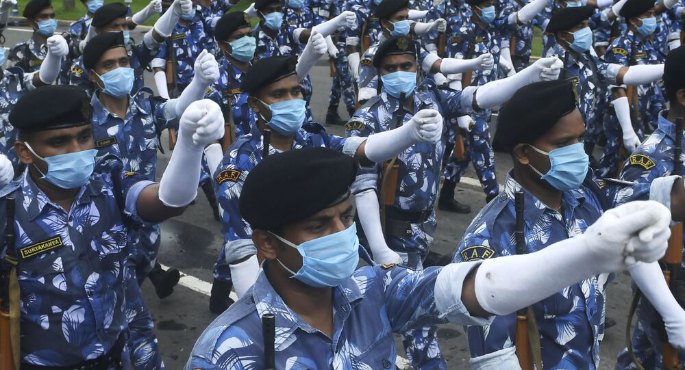 Officers of the state police department wearing face masks take part in a rehearsal ahead of the upcoming Independence Day parade in Kolkata on August 6, 2020