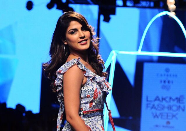 Indian Bollywood actress Rhea Chakraborty showcases creations by designer Jodi at Lakme Fashion Week (LFW) Winter /Festive 2017 in Mumbai on August 18, 2017