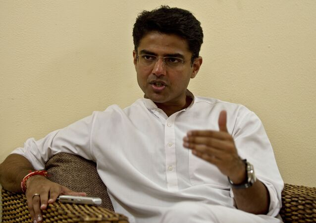 Indian Minister of Corporate Affairs Sachin Pilot gestures during an interview with AFP at his residence in New Delhi on September 27, 2013