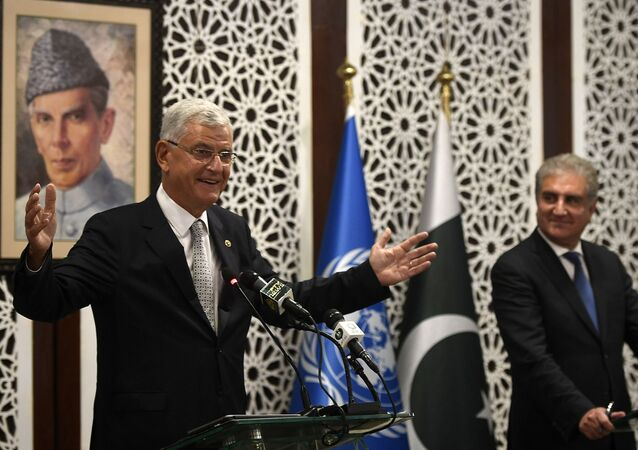 United Nations General Assembly President-elect Volkan Bozkir (L) speaks during a joint press conference with Pakistan's Foreign Minister Shah Mehmood Qureshi in Islamabad on August 10, 2020