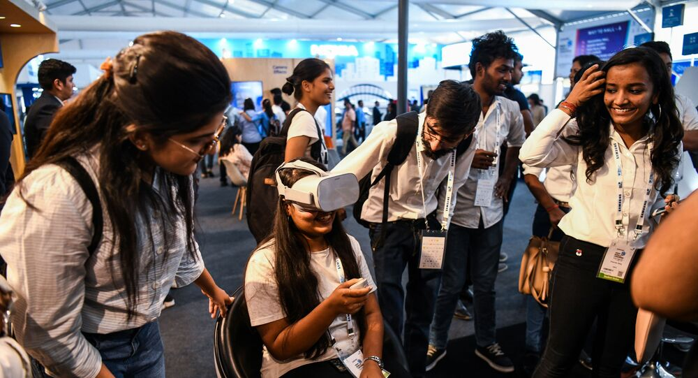 Visitors test a 5G virtual reality demonstration at the India Mobile Congress 2018 in New Delhi on October 25, 2018