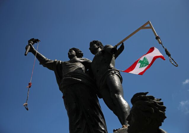 Nooses and a Lebanese flag are placed on a statue on Martyrs' monument, before a protest following the blast in Beirut, Lebanon, August 10, 2020