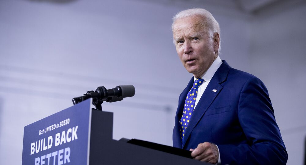 In this July 28, 2020, file photo, Democratic presidential candidate former Vice President Joe Biden speaks at a campaign event at the William Hicks Anderson Community Center in Wilmington, Del.