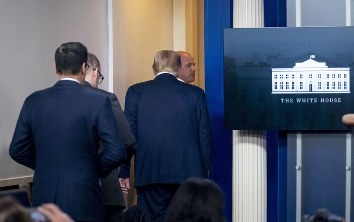 President Donald Trump is asked to leave the James Brady Press Briefing Room by a member of the U.S. Secret Service during a news conference at the White House, Monday, Aug. 10, 2020.