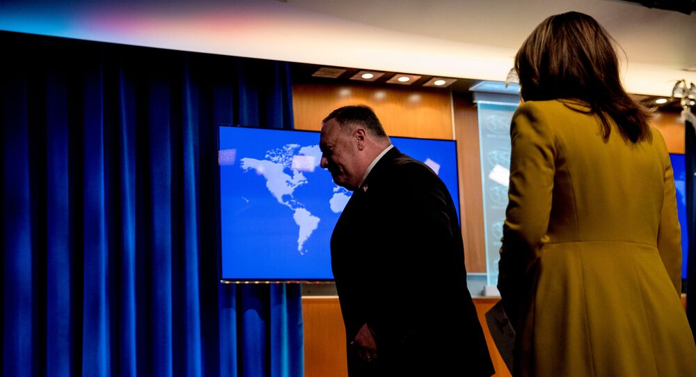 U.S. Secretary of State Mike Pompeo, accompanied by State Department spokeswoman Morgan Ortagus, leaves a news conference at the State Department in Washington, D.C., U.S.,  July 15, 2020.
