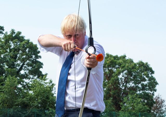 Britain's Prime Minister Boris Johnson takes part in an archery session as he visits Premier Education Summer Camp at Sacred Heart of Mary Girls' School, as the coronavirus disease (COVID-19) outbreak continues, in Upminster, London, Britain August 10, 2020.