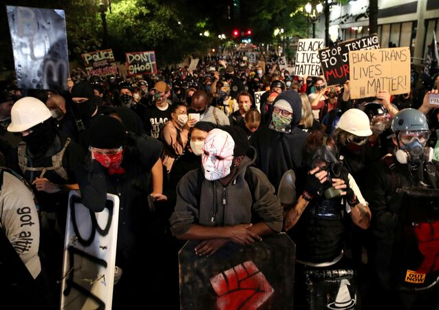 Demonstrators attend a protest against racial inequality and police violence in Portland, Oregon, U.S., August 2, 2020