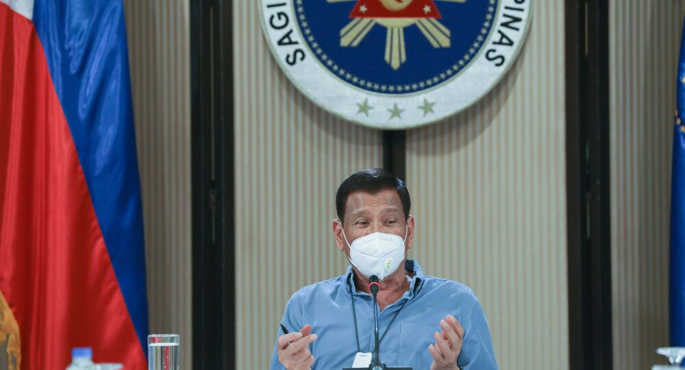 This photo taken April 8, 2020 and received from the Presidential Photo Division on April 9, Philippine President Rodrigo Duterte, wearing a face mask, presides over a meeting with members of the inter-Agency Task Force on the Emerging Infectious Diseases (IATF-EID) in Malacanang Palace in Manila.