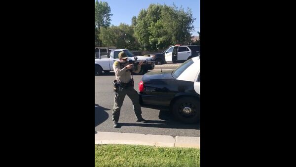 Cellphone recording captures deputies with California's Los Angeles County Sheriff's Department holding teens at gunpoint moments after they were attacked by a knife-wielding individual at a bus stop. An investigation has been launched into the August 7, 2020, encounter. - Sputnik International
