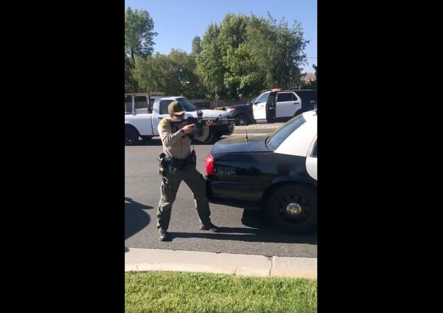 Cellphone recording captures deputies with California's Los Angeles County Sheriff's Department holding teens at gunpoint moments after they were attacked by a knife-wielding individual at a bus stop. An investigation has been launched into the August 7, 2020, encounter.