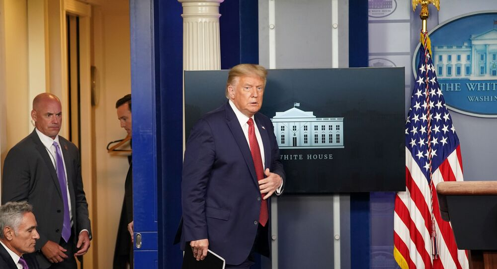 U.S. President Donald Trump arrives during the beginning of a coronavirus disease (COVID-19) pandemic briefing at the White House in Washington, U.S., August 10, 2020