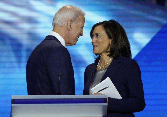 Democratic presidential candidate former Vice President Joe Biden, left, and then-candidate Sen. Kamala Harris, D-Calif. shake hands after a Democratic presidential primary debate hosted by ABC at Texas Southern University in Houston. Biden has chosen Harris as his running mate