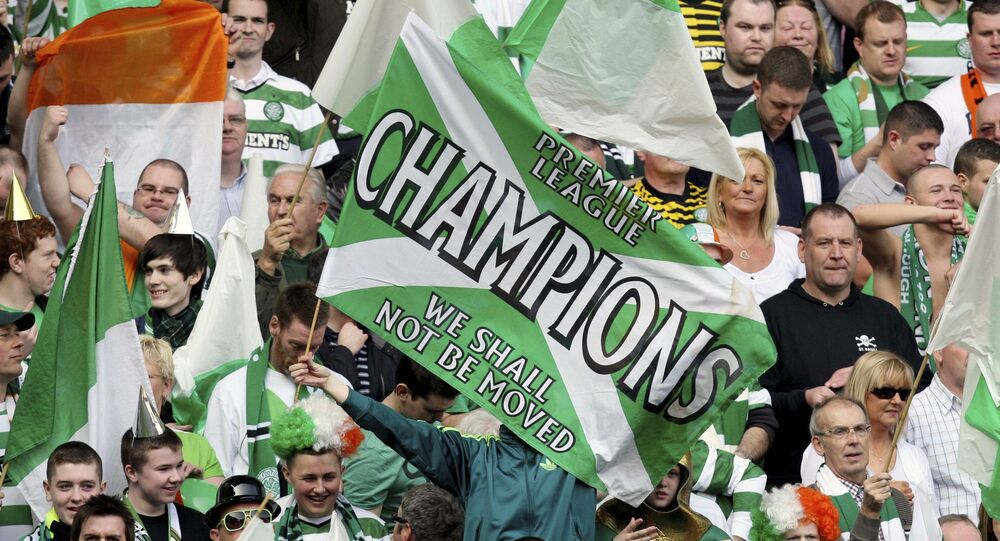 This Sunday, March 25, 2012 file photo shows a general view of Celtic's supporter's during the Scottish Premier League soccer match between Rangers and Celtic at Ibrox, Glasgow, Scotland. Chaos is engulfing Scotland's attempts to deliver a resolution to the season and it might prove to a warning sign to other European leagues weighing up how to conclude a pandemic-affected campaign. The Scottish Professional Football League has on Tuesday, April 14, 2020 asked all 42 clubs in its league system to vote on whether to cancel the season and for final placings to be determined by the points per game of each club.
