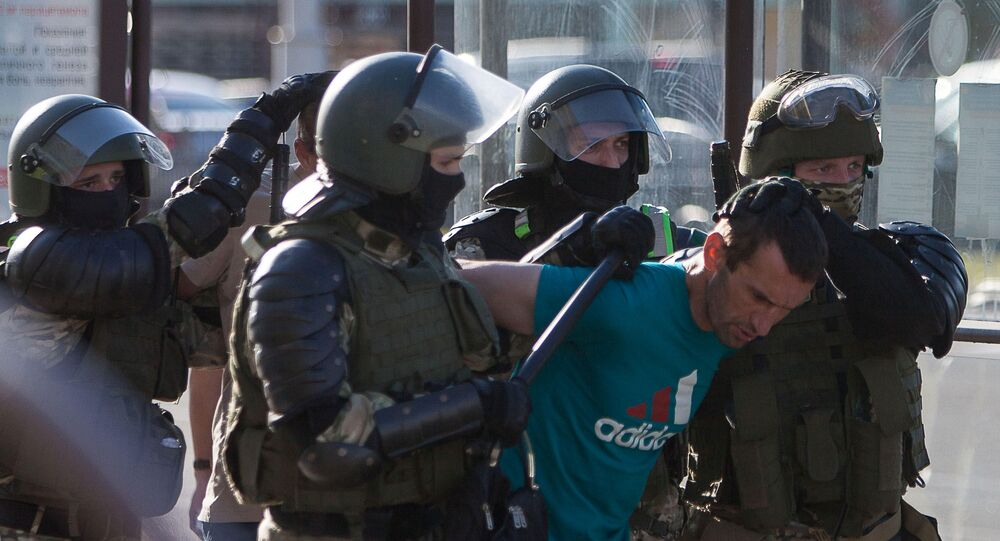 Belarusian law enforcement officers detain a man near the site where a protester died on August 10 during a rally following the presidential election in Minsk, Belarus August 11, 2020. The opposition rejected official election results handing President Alexander Lukashenko a landslide re-election victory