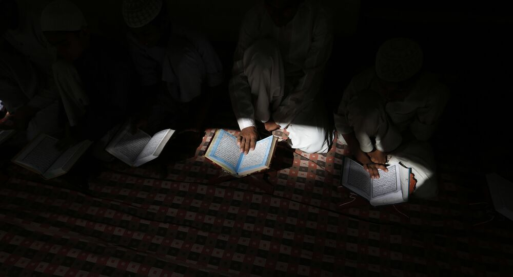 Indian Muslims  read the holy Quran at a mosque in Allahabad, Uttar Pradesh state, India, Tuesday, March 28, 2017