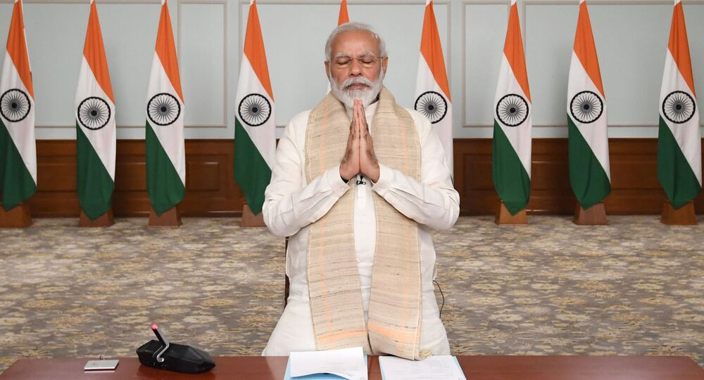 In this photo released by India Government Press Information Bureau, Indian Prime Minister Narendra Modi pays tributes to  Indian soldiers killed during confrontation with Chinese soldiers in the Ladakh region as he holds a video conference with chief ministers, in New Delhi, India, June 17, 2020