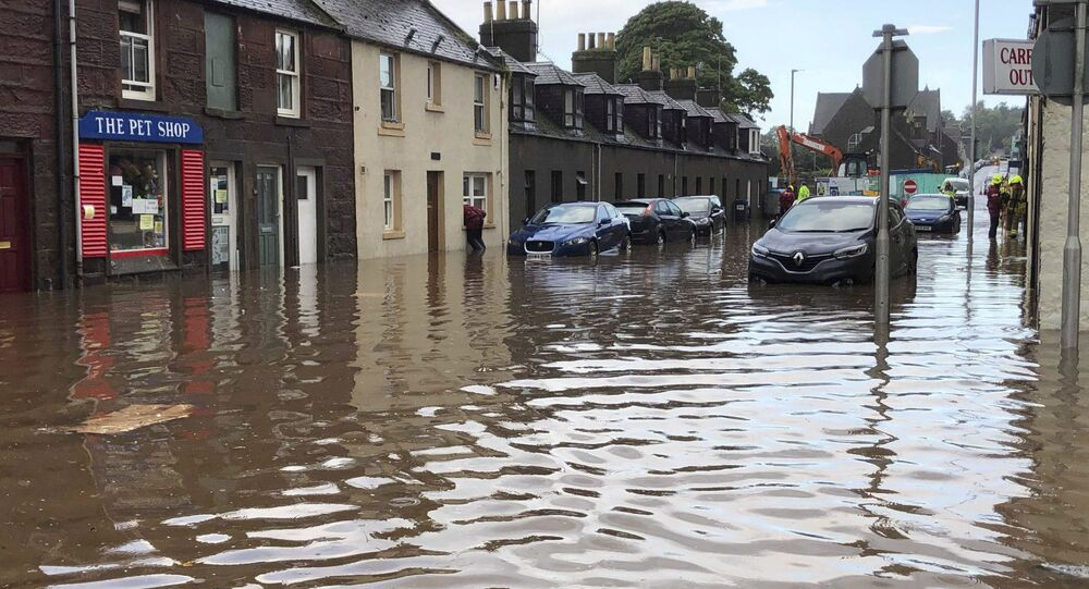 Flooding in Stonehaven, Scotland, Wednesday Aug. 12, 2020, where a nearby train is reported to have derailed