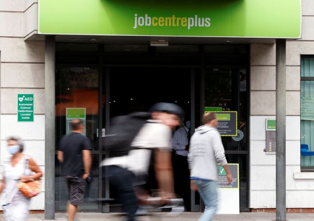 People walk past a branch of Jobcentre Plus, a government run employment support and benefits agency, as the outbreak of the coronavirus disease (COVID-19) continues, in Hackney, London, Britain, August 6, 2020