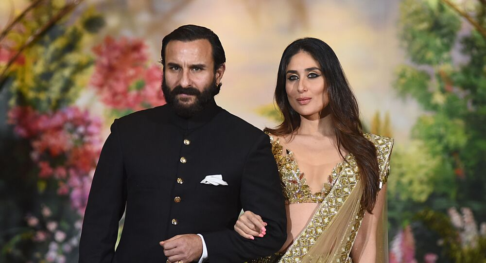 Indian Bollywood actors Saif Ali Khan and wife Kareena Kapoor Khan pose for a picture during the wedding reception of actress Sonam Kapoor and businessman Anand Ahuja in Mumbai late on May 8, 2018