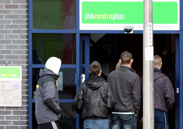 People are seen queuing outside the Jobcentre plus at Gateshead, England (File)