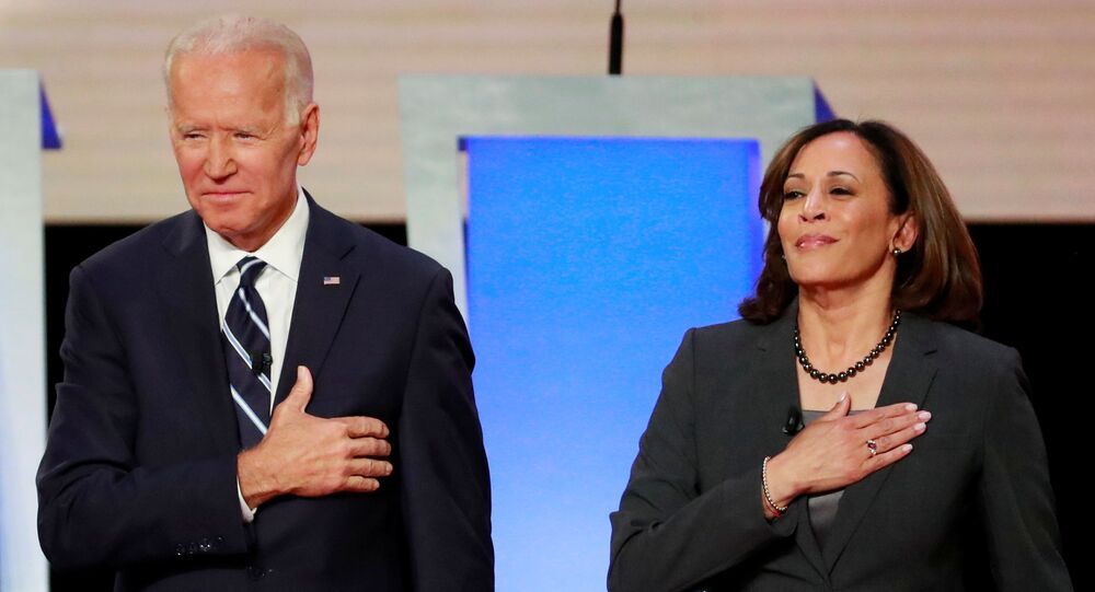 Former Vice President Joe Biden and U.S. Senator Kamala Harris take the stage before the start of the second night of the second U.S. 2020 presidential Democratic candidates debate in Detroit, Michigan, U.S., July 31, 2019.