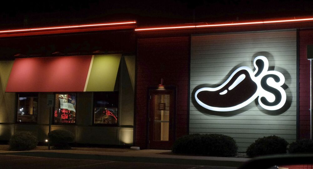 A Chili's restaurant logo stands lit in El Paso, Tex., Wednesday, Oct. 23, 2019.