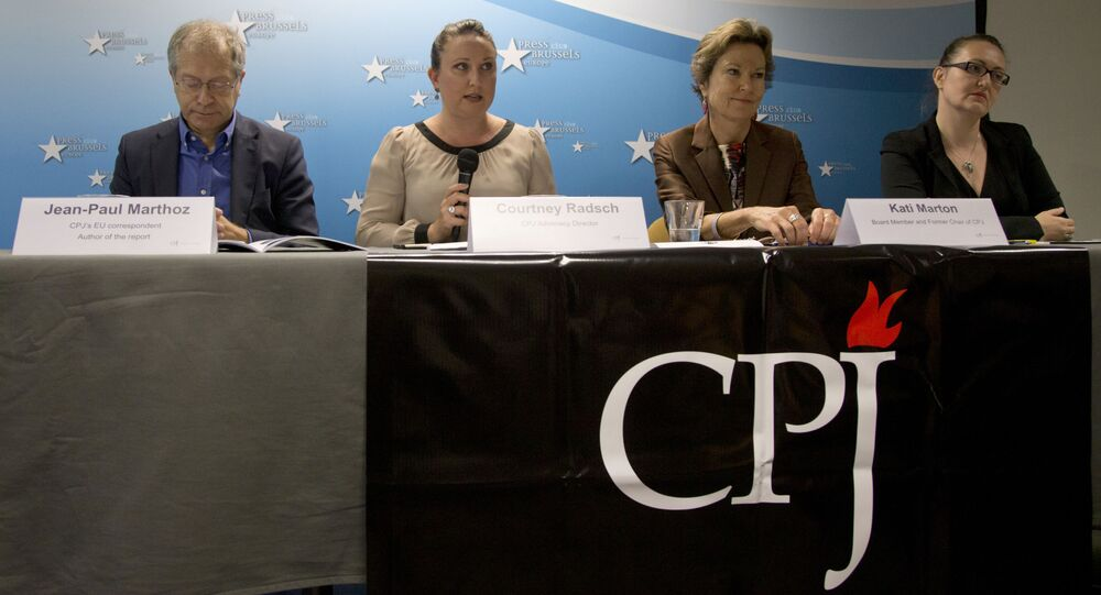 From left, EU correspondent for the Committee to Protect Journalists, Jean-Paul Marthoz, Advocacy Director for the CPJ, Courtney Radsch, Board member and former chairperson for the CPJ, Kati Marton and Central Asia Program Coordinator for the CPJ, Nina Ognianova address a media conference  in Brussels on Tuesday, Sept. 29, 2015.