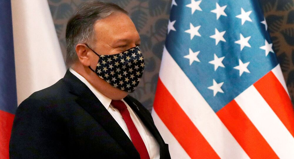 U.S. Secretary of State Mike Pompeo wears a star-spangled mask as he arrives for a joint news conference with the Czech prime minister, at the start of a four-nation tour of Europe, in Prague, Czech Republic August 12, 2020.