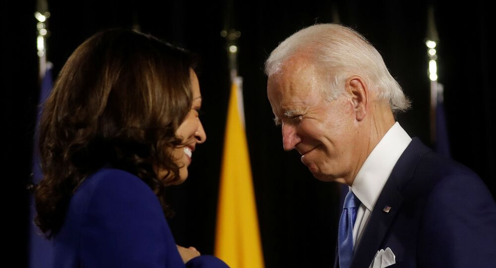 Democratic presidential candidate and former Vice President Joe Biden and vice presidential candidate Senator Kamala Harris are seen at the stage during a campaign event, their first joint appearance since Biden named Harris as his running mate, at Alexis Dupont High School in Wilmington, Delaware, U.S., August 12, 2020
