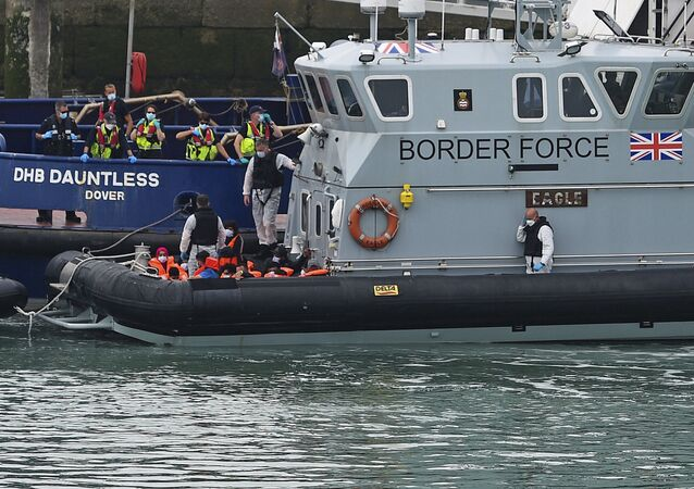 A group of people thought to be migrants are brought into Dover, England, Wednesday Aug. 12, 2020, by Border Force officers. (Kirsty O'Connor/PA via AP)
