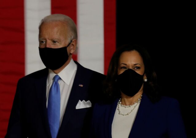 Democratic presidential candidate and former Vice President Joe Biden; and vice presidential candidate Senator Kamala Harris take the stage at a campaign event, their first joint appearance since Biden named Harris as his running mate, at Alexis Dupont High School in Wilmington, Delaware, U.S., August 12, 2020.