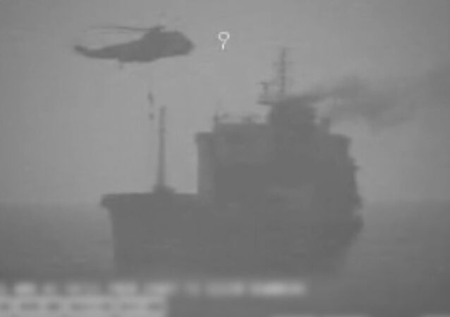 In this image made from video released by the U.S. military's Central Command, Iranian commandos fast-rope down from a helicopter onto the MV Wila oil tanker in the Gulf of Oman off the coast of the United Arab Emirates on Wednesday, Aug. 12, 2020