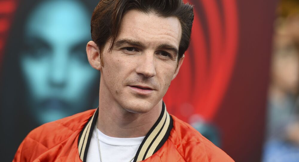 Drake Bell arrives at the world premiere of The Spy Who Dumped Me on Wednesday, July 25, 2018 in Los Angeles