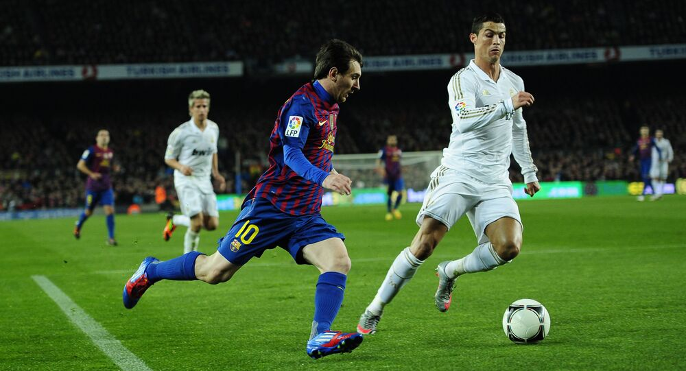 FC Barcelona's Lionel Messi, from Argentina, left, duels for the ball against Real Madrid's Cristiano Ronaldo, from Portugal, during their quarterfinal, second leg, Copa del Rey soccer match at the Camp Nou stadium, in Barcelona, Spain, Wednesday, Jan. 25, 2012