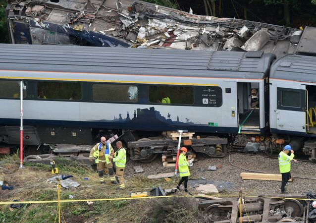 Emergency services inspect the site, following the derailment of the ScotRail train which cost the lives of three people, near Stonehaven, Aberdeenshire, Scotland, Britain August 13, 2020.
