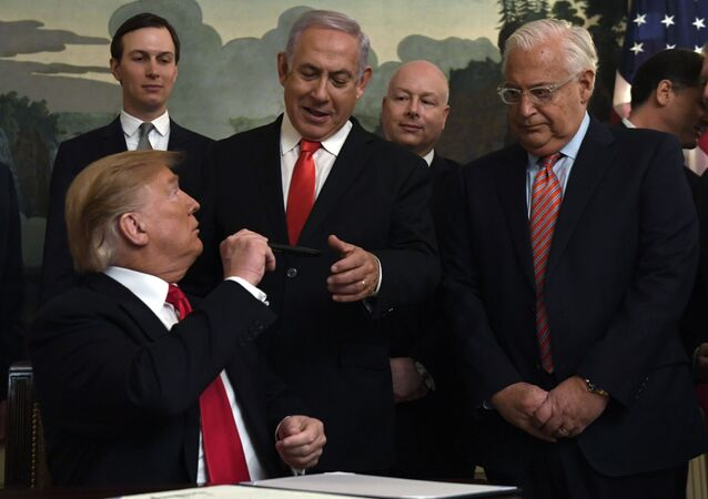 President Donald Trump, left, turns to give a pen to Israeli Prime Minister Benjamin Netanyahu, center, after signing a proclamation in the Diplomatic Reception Room at the White House in Washington, Monday, March 25, 2019. Trump signed an official proclamation formally recognizing Israel's sovereignty over the Golan Heights. Other attending are, from left, White House adviser Jared Kushner, U.S. special envoy Jason Greenblatt, U.S. Ambassador to Israel David Friedman, Israeli Ambassador to the U. S. Ron Dermer, and Secretary of State Mike Pompeo.