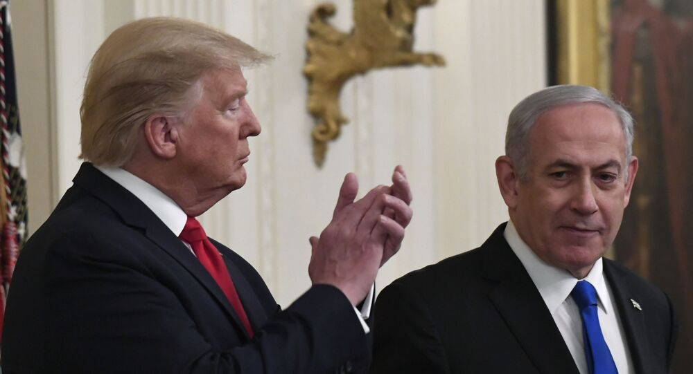 President Donald Trump, left, listens as Israeli Prime Minister Benjamin Netanyahu, right, speaks during an event in the East Room of the White House in Washington, Tuesday, Jan. 28, 2020, to announce the Trump administration's much-anticipated plan to resolve the Israeli-Palestinian conflict.