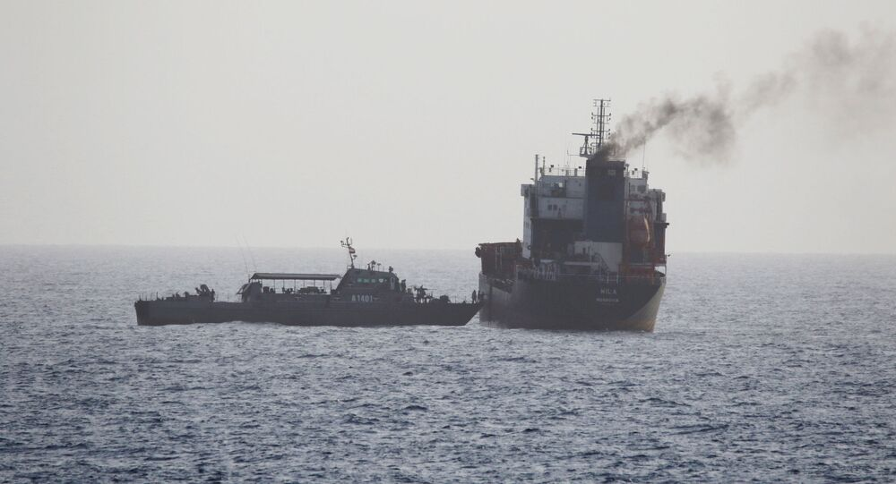 In this Wednesday, Aug. 12, 2020 photo released by the U.S. Navy, the MT Wila is boarded by Iranian navy commandos in the Gulf of Oman off the eastern coast of the United Arab Emirates. The Iranian navy boarded and briefly seized a Liberian-flagged oil tanker near the strategic Strait of Hormuz amid heightened tensions between Tehran and the U.S., a U.S. military official said Thursday, Aug. 13, 2020. (U.S. Navy via AP)